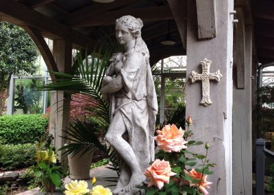Cast Stone fIgure and Greenery grown roses